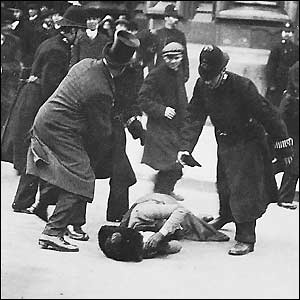 The suffragettes, founded in October 1903, forced a social revolution to give women the vote. Photographs uncovered by the National Archives reveal hidden secrets of how the state spied on what it regarded as a terrorist threat. This picture shows a suffragette caught in a confrontation with opponents and the police.