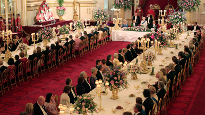 It will be lobster ravioli and aged Highlands beef tonight as President Obama and first lady Michelle Obama repay Queen Elizabeth II after last night's state dinner at Buckingham Palace. The Obamas host the queen at Winfield House, the home of the U.S. ambassador to Britain -- and not just the queen. Among those on the guest list: actors Tom Hanks and Colin Firth, author J.K. Rowling and soccer star David Beckham. Also on the menu: crushed jersey royals, asparagus and minted broad beans. The dessert: pecan pie and brandy ice cream. After the meal, the guests will be entertained by Tony Award-winning actress and singer Kristin Chenoweth
